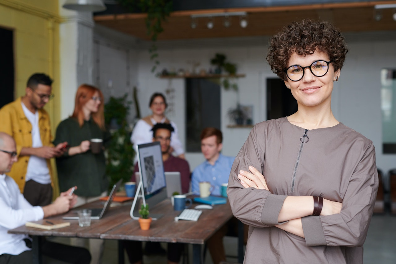 Woman as a leader with people behind