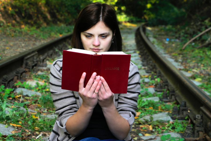Satisfied woman book reader after applying Six Sigma for book publishing