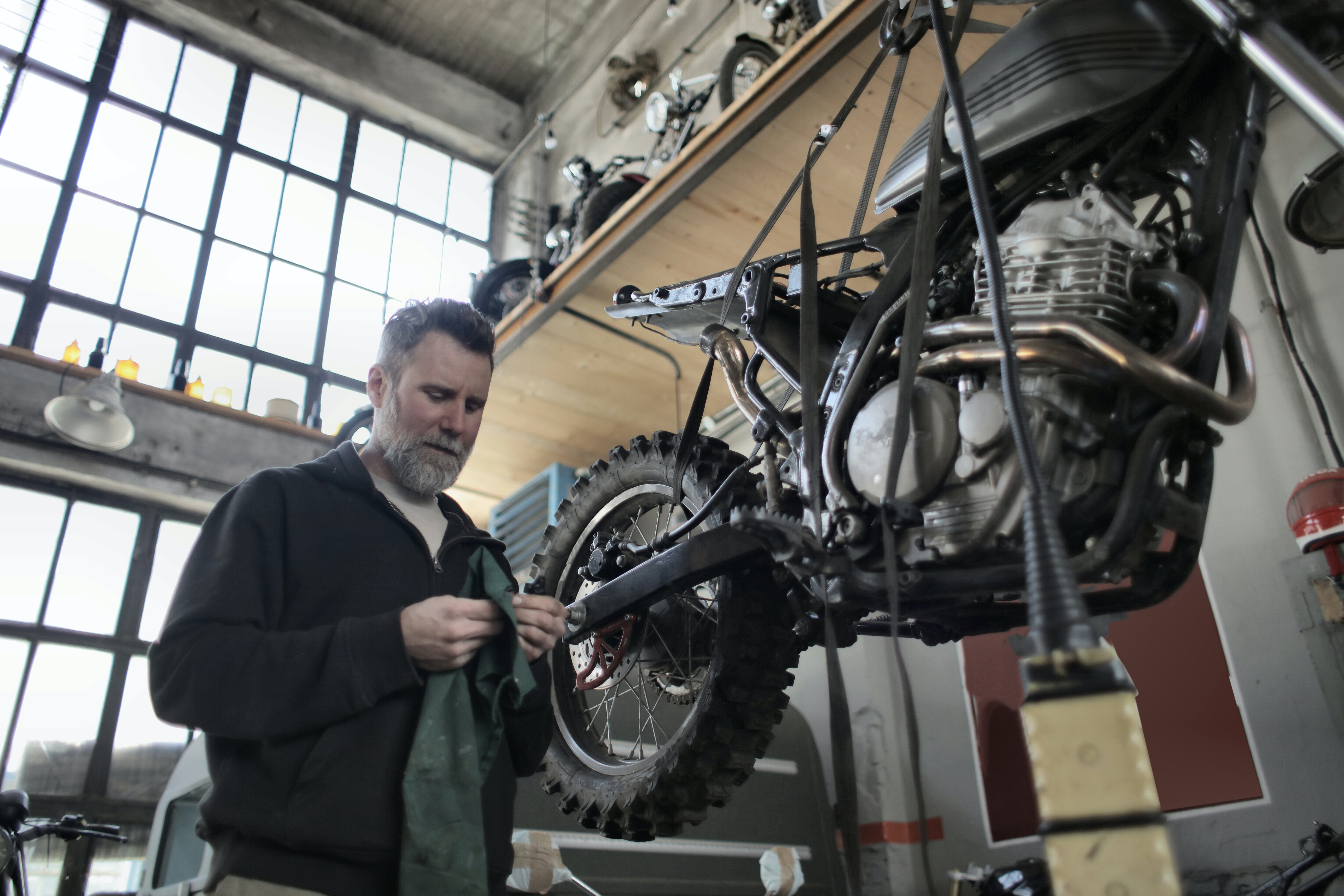 man working to improve the bike