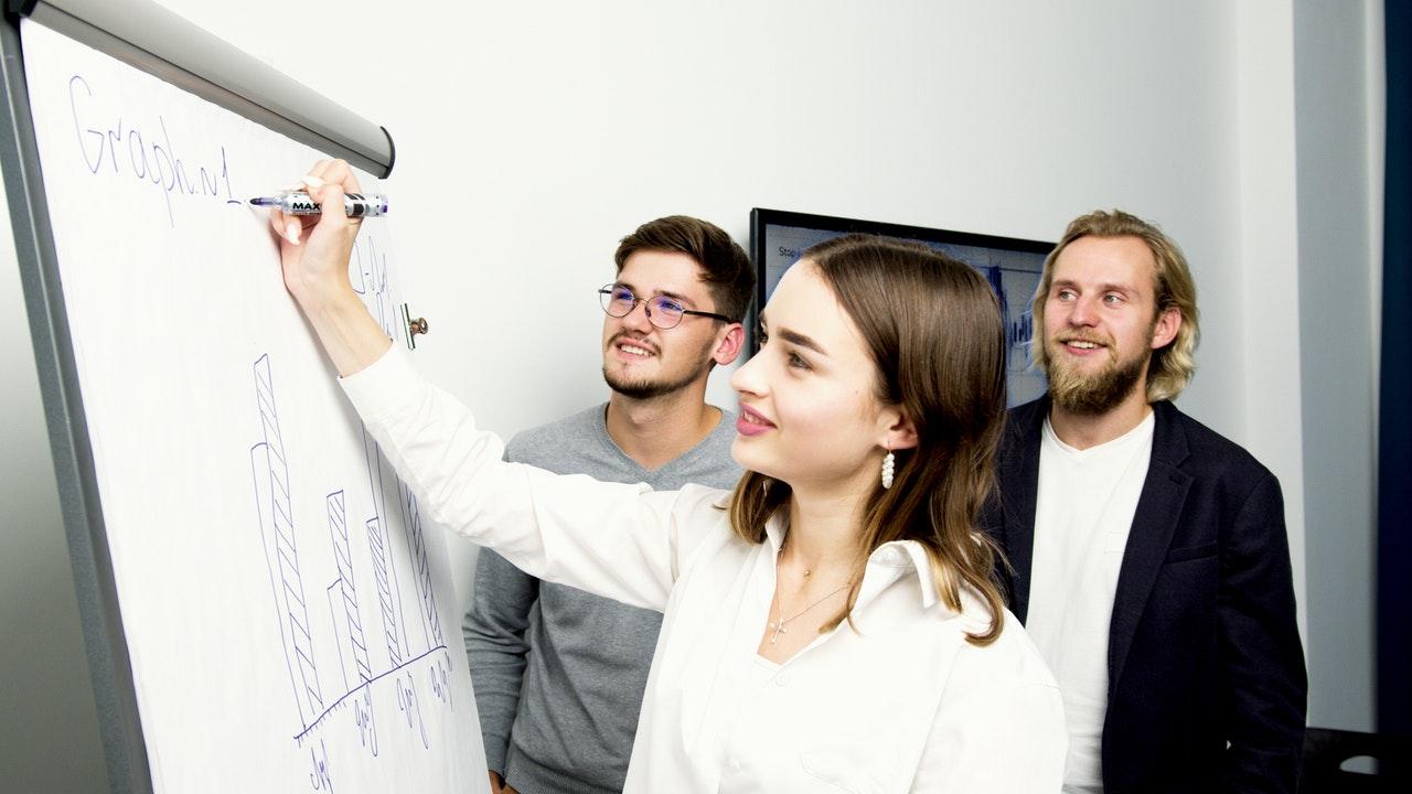 Team comparing the Lean Six Sigma in Banking scenarios