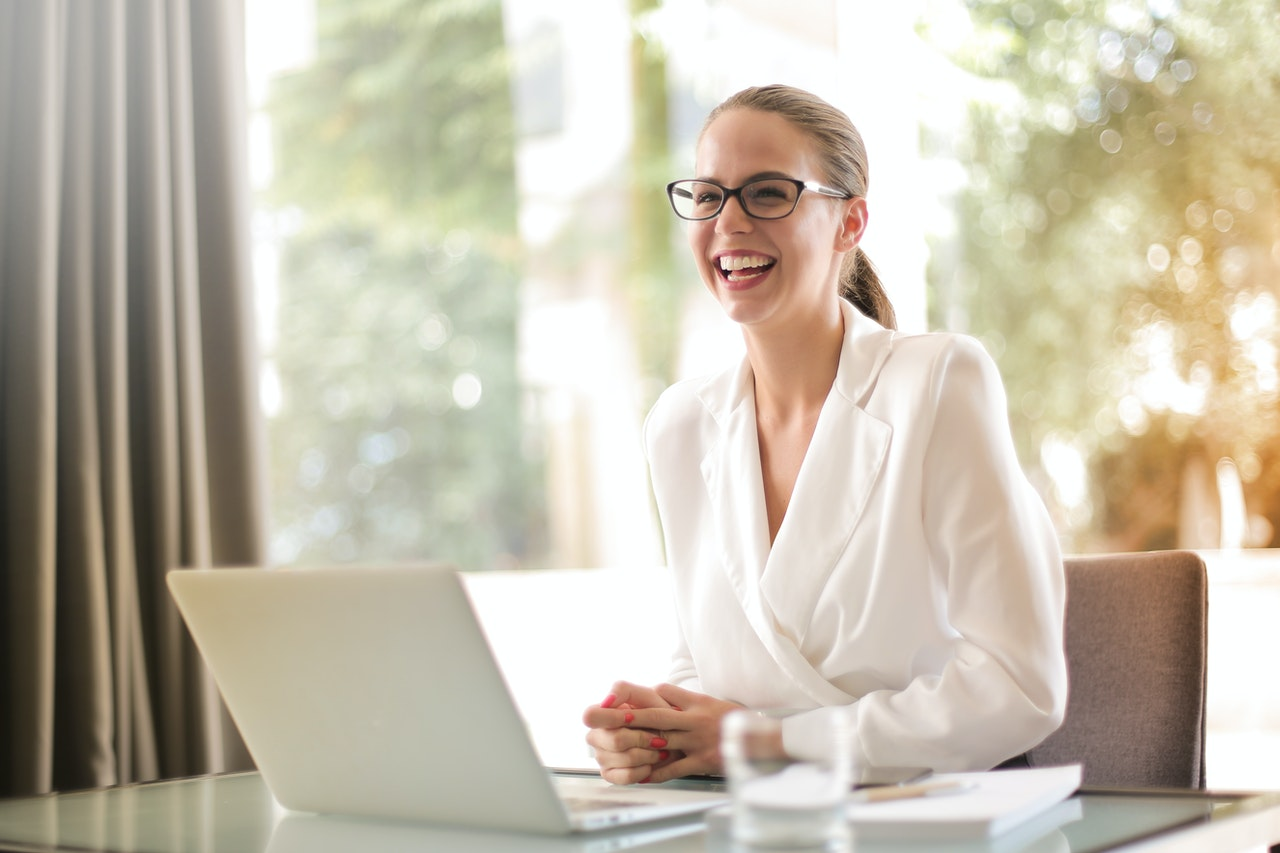 Woman communicating Management theories happily